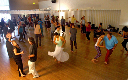 Every style of movement is welcome at Open Floor -- some participants even sit still as the dance swirls around them. Photo by Veronica Weber.