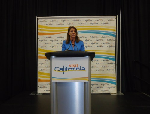 "Caroline Beteta, president and CEO of Visit California, opens news conference attended by more than 250 journalists, who had questions on everything from ""What's new?"" to ""What are you doing to deal with the water shortage?"""