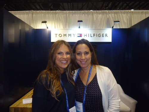 Good Company: Directly opposite TheTourOperator.com is the booth of the upscale apparel brand, Tommy Hilfiger, with Lisa Pappas (left), senior manager, regional marketing; and Laura Burbaro, manager, regional West.