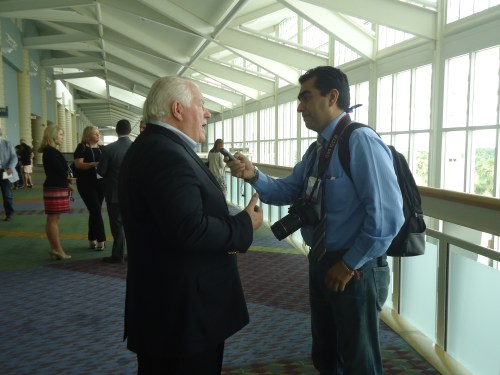 Roger Dow, president and CEO of the U.S. Travel Association, does a one-on-one interview with Carlos Galván, a radio news reporter from Mexico.