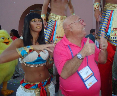 Clearly enjoying his predicament—being trapped midst a swirl of dancing Egyptians come to life after thousands of years—Paulo Roberto Miranda, chairman and CEO of Brazil's Grupo Travel News, gives a thumbs up to show his approval of the situation.
