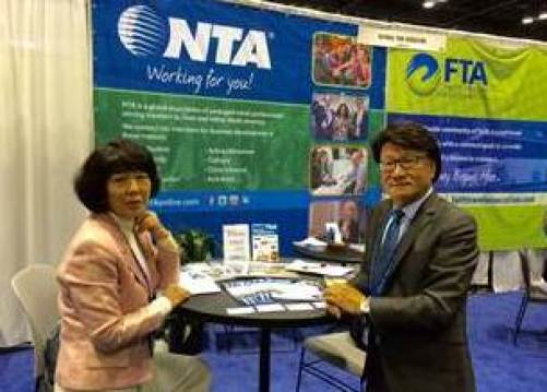 (C)—Ms. Haybina Hao, director of international development, NTA, and Daniel Shen, president of Lion Tours USA Inc./East & West Marketing. Photo by Barry Zhang, U.S. Commercial Service Guangzhou, China