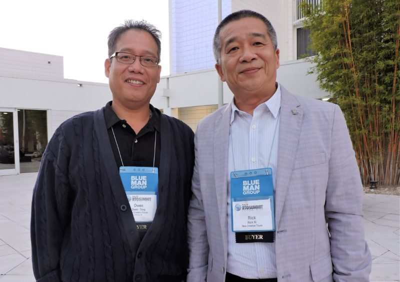 Stepping outside to enjoy the closing reception for day one of the RTO Summit are: Owen Tang (left) and Rick Xi, of Orland-based New Creative Tours.