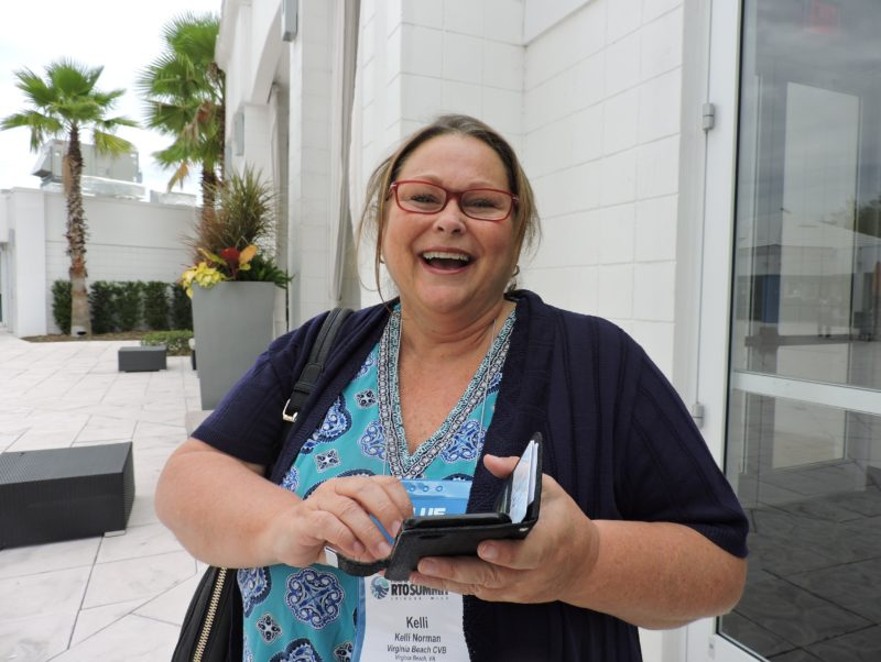 . Kelli Norman, director of tourism marketing and sales, Virginia Beach CVB, finds that stepping outside during a morning coffee break was an ideal place for checking messages.