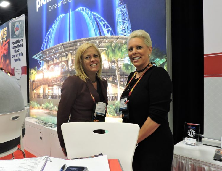 At the earl enterprises booth: Roxanna Torrrens (left), senior director of travel industry sales; and Gretchen Heppler, director of national sales and partnerships.