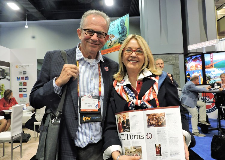 Jake Steinman, founder and CEO of the NAJ Group, with Noel Irwin-Hentschel, founder and chairman of AmericanTours International (ATI), who is showing NAJ's IPW magazine article commemorating the 40th anniversary of ATI.