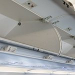 American Airlines Just Announced a New Way To Stop Passengers Stealing Overhead Bins In The Wrong Class