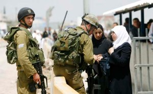 Palestinians wait to cross the Hawara checkpoint on the outskirts of the West Bank city of Nablus