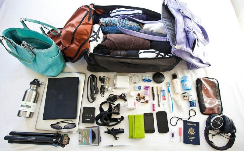 Why check a bag, ever, when I can fit what I need for up to a month in a single rollaboard and second small bag?