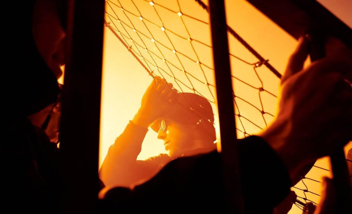 Feyenoord supporter in Bern tijdens de pyroactie bij de wedstrijd tegen Young Boys - Feyenoord