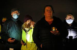 People at a candlelight vigil at the Llewellyn Estate in Ballinteer, south Dublin after the bodies of a woman and two young children were discovered (Brian Lawless / PA Wire)