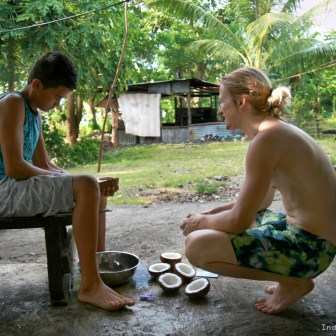 """Samoan boy, coconuts, preparing coconuts, """"You Have To Be Rich To Travel"""": Top 4 Travel Myths Busted!"""
