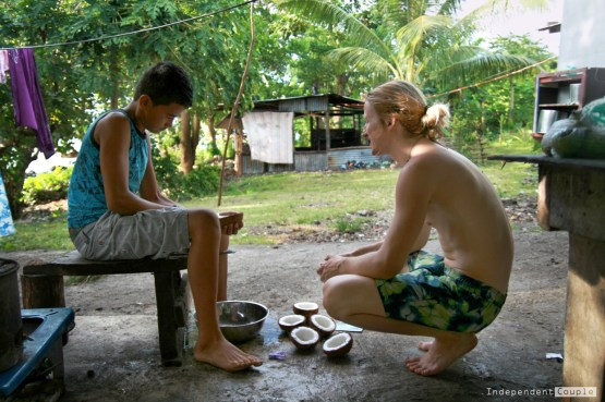 "Samoan boy, coconuts, preparing coconuts, ""You Have To Be Rich To Travel"": Top 4 Travel Myths Busted!"