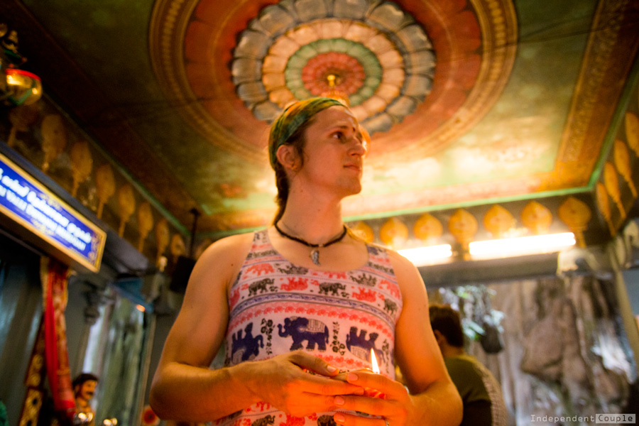 Praying in the hindu temple in Batu Caves, Kuala Lumpur. Batu Caves, travel myths