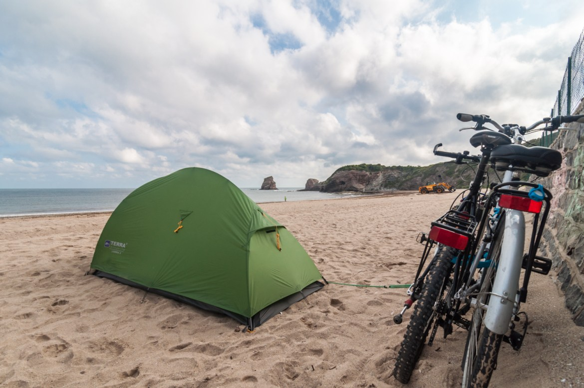 independent people basque tent camping beach bicycle