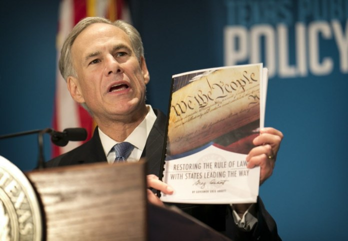 Gov. Greg Abbott calls for a convention of states to amend the Constitution during a speech at the Texas Public Policy Foundation in Austin, Texas, Friday, Jan. 8, 2016. Abbott called on Texas to take the lead in pushing for constitutional amendments that would give states power to ignore federal laws and override decisions by the U.S. Supreme Court. (Jay Janner/Austin American-Statesman via AP) MANDATORY CREDIT