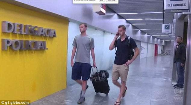 Detention: Gunnar Bentz (left) and Jack Conger (right) are pictured at Rio Galeao International Airport after being removed from a return flight back to the United States Read more: http://www.dailymail.co.uk/news/article-3746324/U-S-Olympic-swimmers-Gunnar-Bentz-Jack-Conger-REMOVED-flight-Brazilian-authorities-following-Ryan-Lochte-s-claim-robbed-gunpoint.