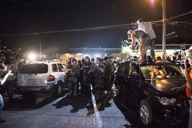 Journalists covering the protests in Ferguson, Missouri (Photo:  Abe Van Dyke/Demotix)