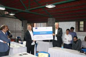 H.E Riho Kruuv and Klaus Pendl holding the winner certificate of the Hackathon in IISc Bangalore