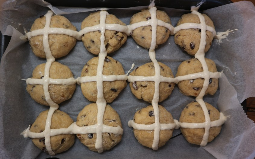 adding crosses to the buns