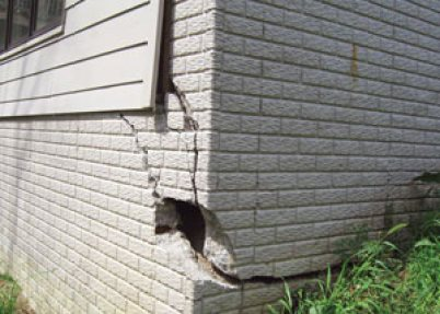 A severely damaged foundation wall in Carmel