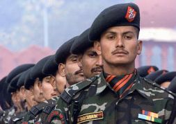 Indian soldiers from the Rashtriya Rifles take part in a full dress rehearsal for the upcoming Army Day in New Delhi January 13, 2003. India will celebrate its annual Army Day on January 15. REUTERS/B. Mathur JSG/RCS