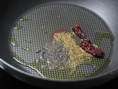 Heating oil for tempering spices for Moong Dal