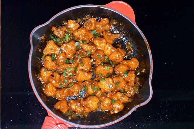Garnish gobi manchurian with spring onions