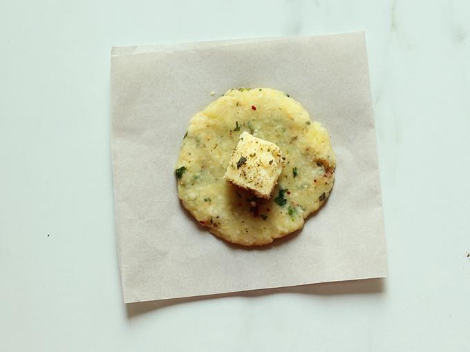 spreading mashed potato to disc