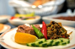A greater selection of Indian dishes, especially vegetarian options, is being offered. This picture features a tamarind-garnished sprout salad served on the Ahmedabad route.