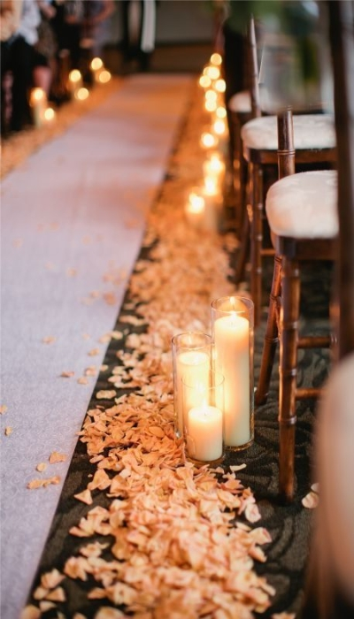 Rose petals and candles of varied sizes - Aisle Decoration Ideas