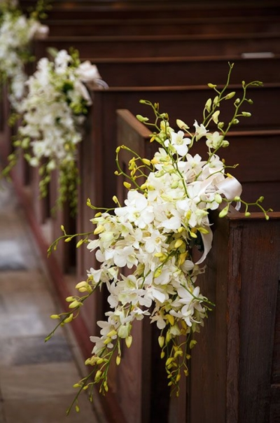 White dendrobium orchids tied with satin ribbons onto the pews - Aisle Decoration Ideas