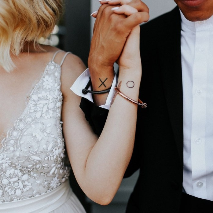 wedding sign tattoo on wrist