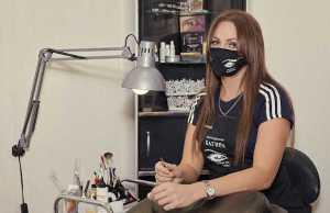 Coronavirus - Salon artist wearing a mask