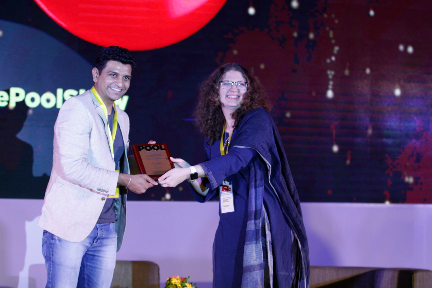 Hari Nallan, and Aashish Solanki, receive mementos from Marianna Sharma, Head Strategist at INDI Design, and Digital and Design at POOL Magazine.