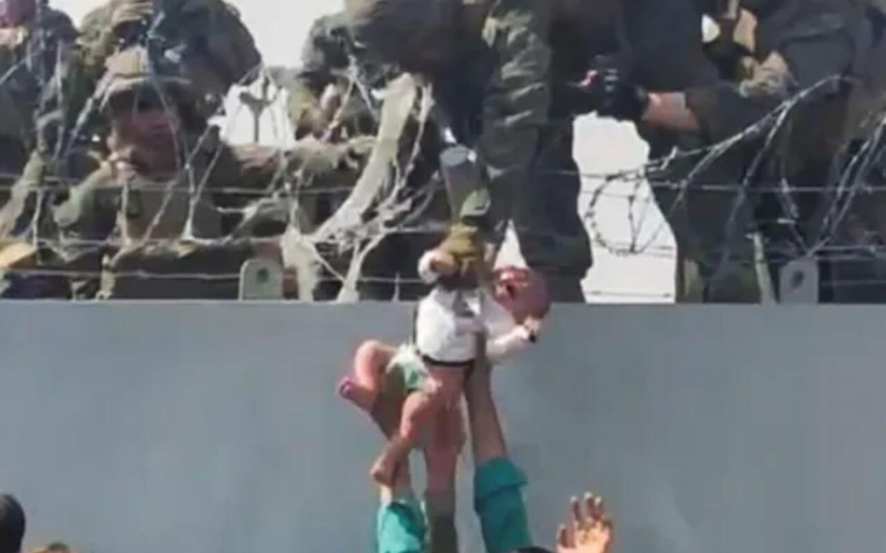 Afghan Women Throw Babies Over Barbed Wire at Kabul airport