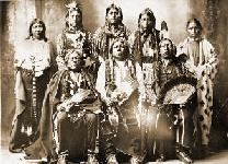 Tonkawas: (standing left to right) Winnie Richards,  John Rush Buffalo, William Stevens, John Allen,  Mary Richards; (seated left to right) John Williams,  Chief Grant Richards, Sherman Miles.