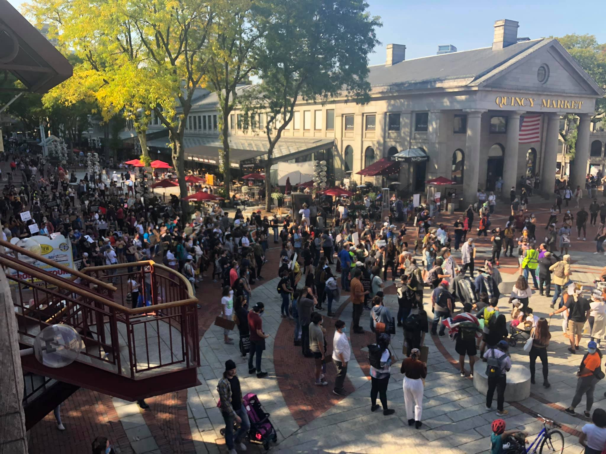Crowd of several hundred people in Indigenous Peoples Day march gathered outside Faneuil Hall