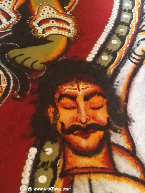 रंगोली पे बना दाराकासुर का सिर