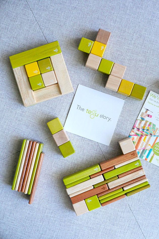 Tegu magnetic building blocks laid out in a pattern.
