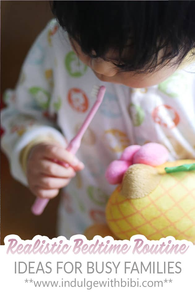 Baby holding onto a toothbrush getting ready for bed as part of a realistic bedtime routine.