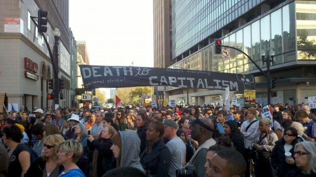 "Huge ""Death to Capitalism, General Strike!"" banner"
