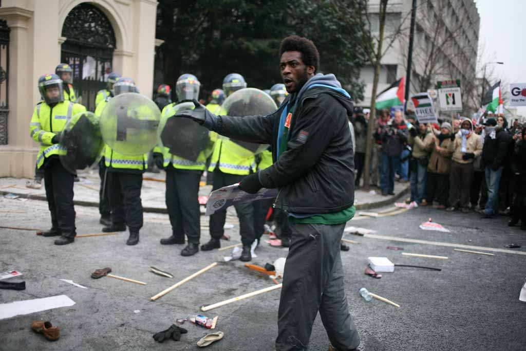 Protester in shock unable to explain the presence of anti-riot officers.