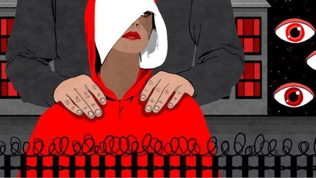 Damızlık Kızı simgeleyen beyaz baş örtüsü ve kırmızı pelerin.jpg
