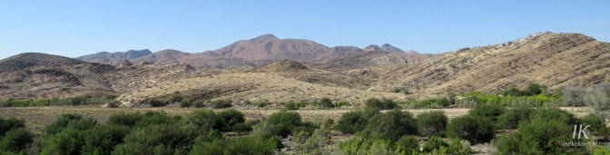 The mountains of Tsaobis Nature Park, with the Swakop river (including the Shitty Woodland) in front.