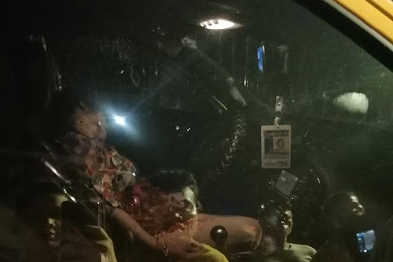 Castro slumped inside her car