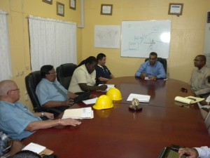 Minister of Natural Resources and the Environment, Robert Persaud, Permanent Secretary Joslyn McKenzie, Representatives of the Guyana Geology and Mines Commission and the Ministry of Labour during a meeting with the management of Bosai, Linden, Region 10