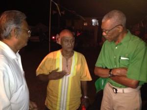 Mr. Granger and Dr Roopnarine chat with PNC/R stalwart Mr James Rampersaud. [Photo: J. Anthony Bond]