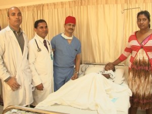 This patient is flanked by her doctors and mother, after successfully undergoing open heart surgery at the Balwant Singh Hospital/ [iNews' Photo]