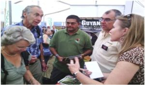 Director of the Guyana Tourism Authority (GTA), Indranauth Haralsingh interacting with patrons at the Guyana booth at the International Bird Watching Fair in England